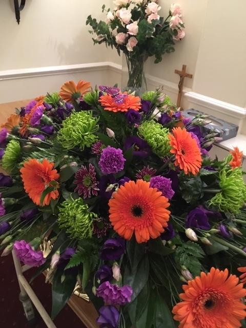 vibrant coffin flowers