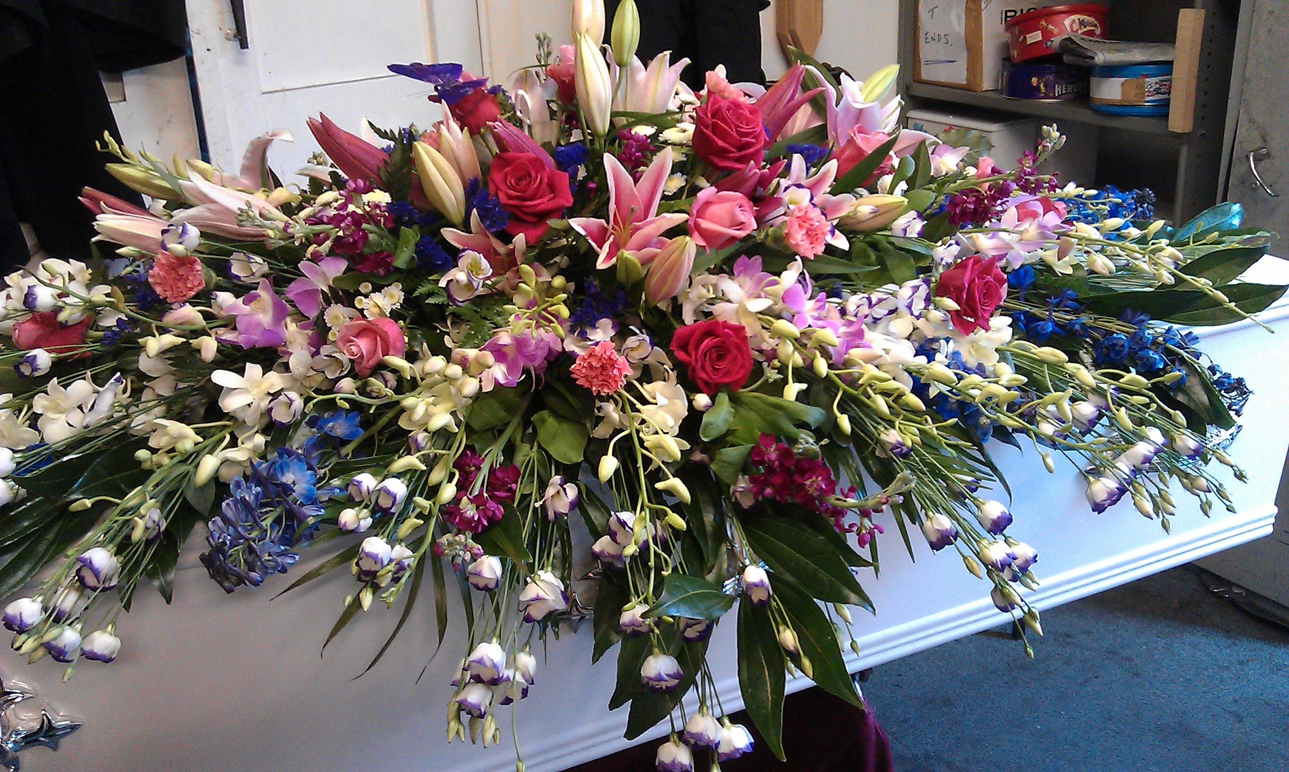 Cascading flowers for coffin